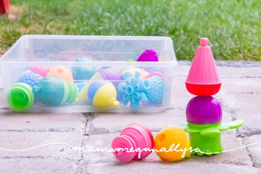 some large colorful plastic lalaboom beads sitting on the patio