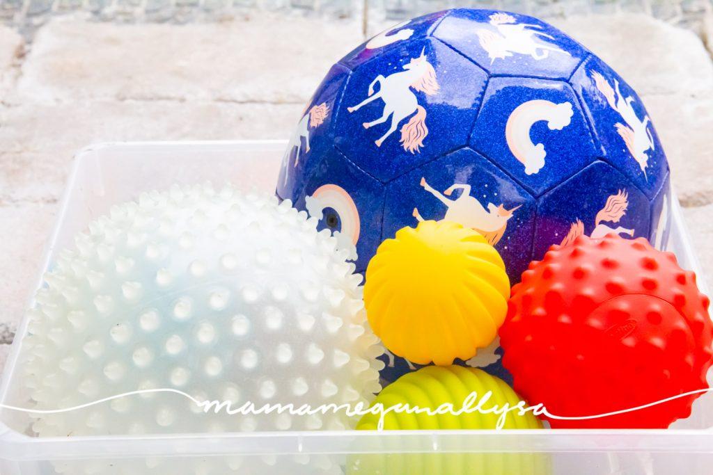 a random selection of balls in a plastic bin