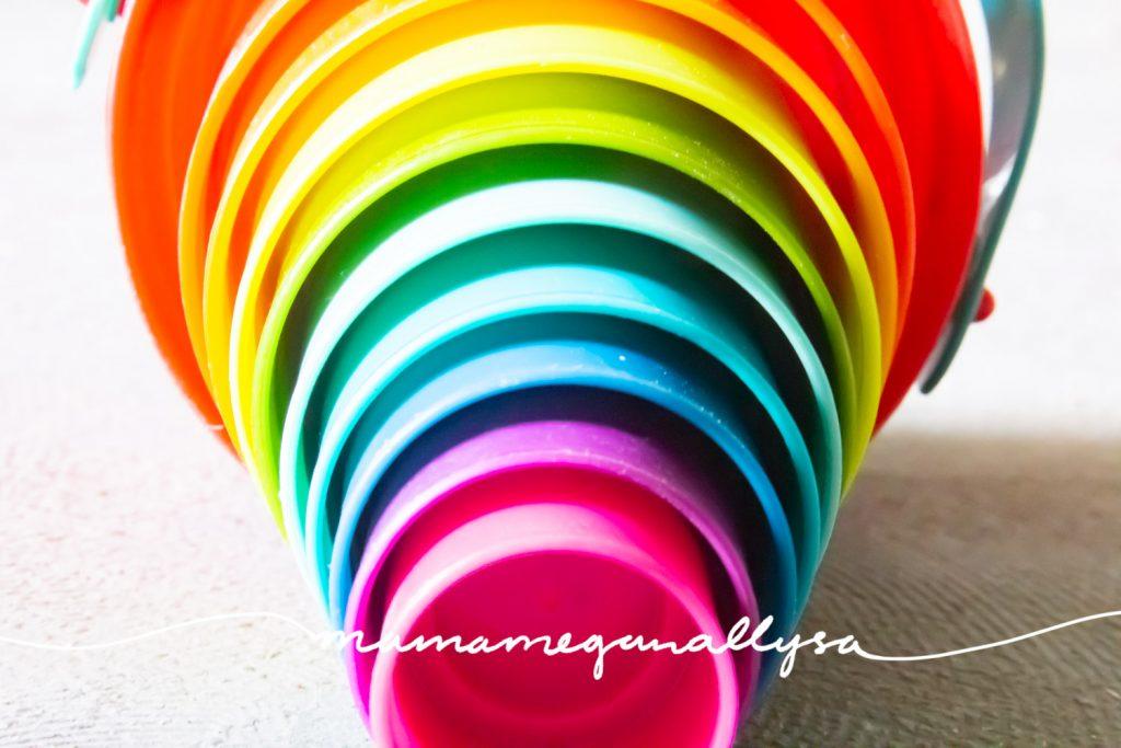 a set of rainbow nesting buckets