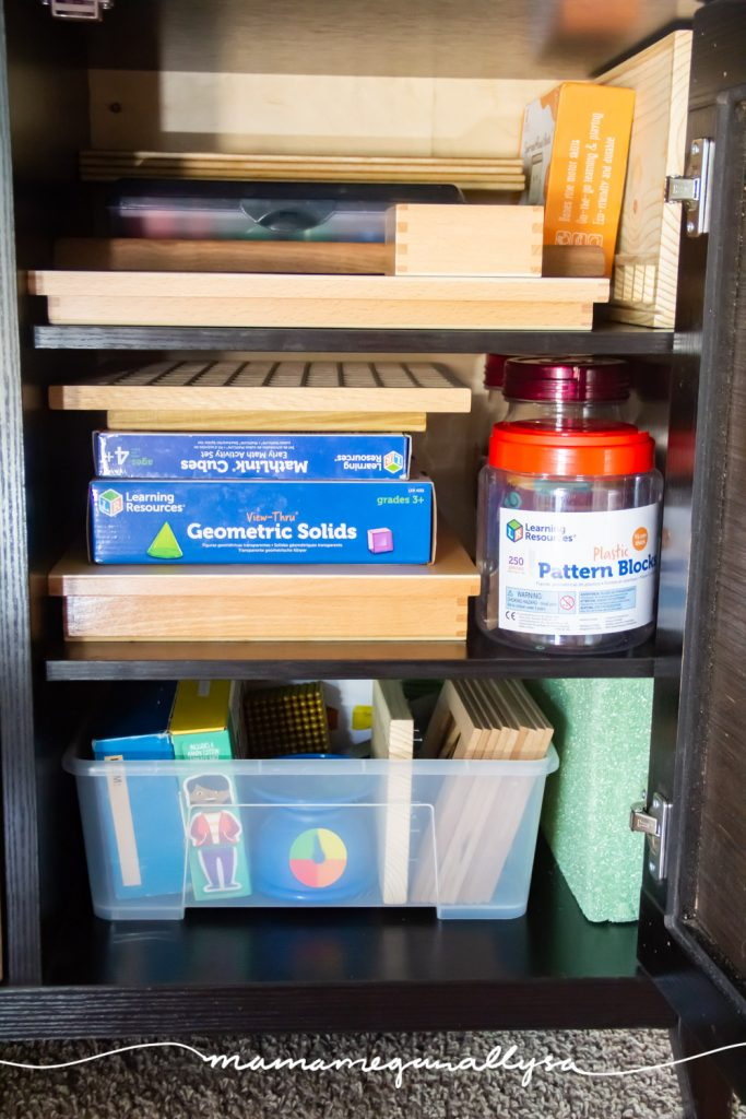 a bunch of our different homeschool materials in our sofa cabinet