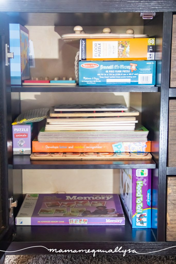 a bunch of different kinds of puzzles in our sofa cabinet
